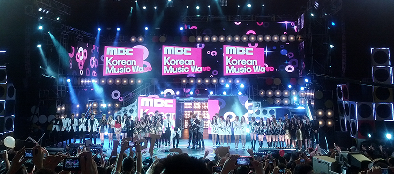 Bands on stage at a K-pop concert